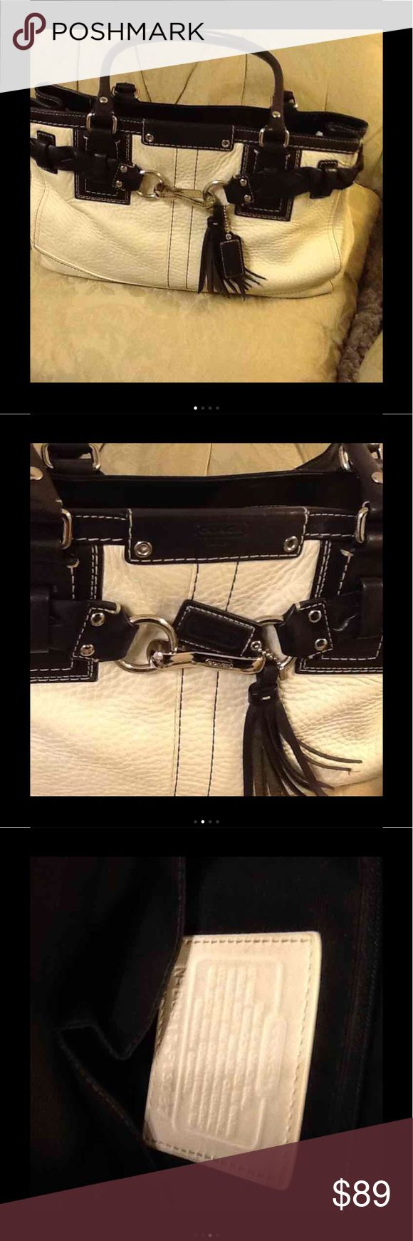 "🖤Pebbled leather Coach bag🖤 Gorgeous Coach shoulder bag in a cream pebbled leather (almost white) with black strong leather handle and trim.Silver detail and tassels. All black lining inside bag which is in excellent condition.size 8.25"" high X 14"" across X 4"" deep. Great price original $289 their is a microscopic faded ink mark in the back of the bag.(very difficult to c)No shoulder strap Coach Bags Satchels"