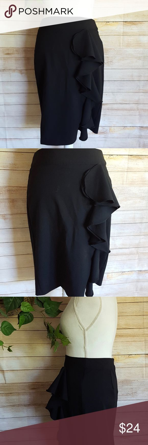 "Charlotte Russe Black Pencil Skirt w/ Ruffle Sz M Charlotte Russe Womens Black Pencil Skirt  Ruffle in the front. Stretchy.  7.5"" slit in back. Not lined.  Back zip closure. Size M.  71% polyester. 26% rayon. 3% spandex. Perfect for the office or to dress up for an evening on the town. Gently used condition with no flaws. Please see photos for details.  All measurements are taken laid flat, unstretched. Waist:  15 inches.. Length:  22.5 inches. Charlotte Russe Skirts"