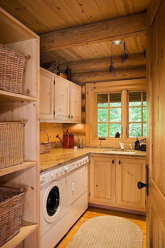 Rustic Lodge Beautiful Laundry Rooms | Design Tip: Laundry Room Styles This laundry room clearly belongs to a rustic lake house or lodge!  The exposed timber walls and thick ceiling beams give the space all the character it needs, leaving the decorative touches simple and refined.
