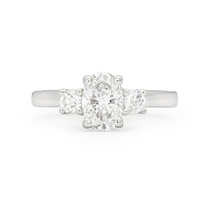 *Ascot* - This gleaming diamond ring has been created in platinum metal with a combination of round brilliant and oval cut diamonds together. The breathtaking oval centre diamond is hugged by two smaller round diamonds giving this ring a wonderful symmetry.Total Diamond Carat Weight 1.30ct.