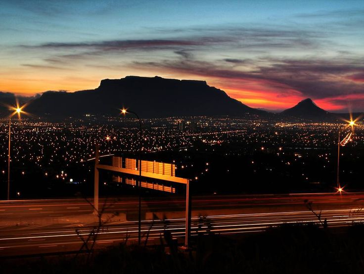 Slow it down...  and take some time to enjoy the beautiful view.    What an amazing sunset behind table mountain. So blessed to live here.