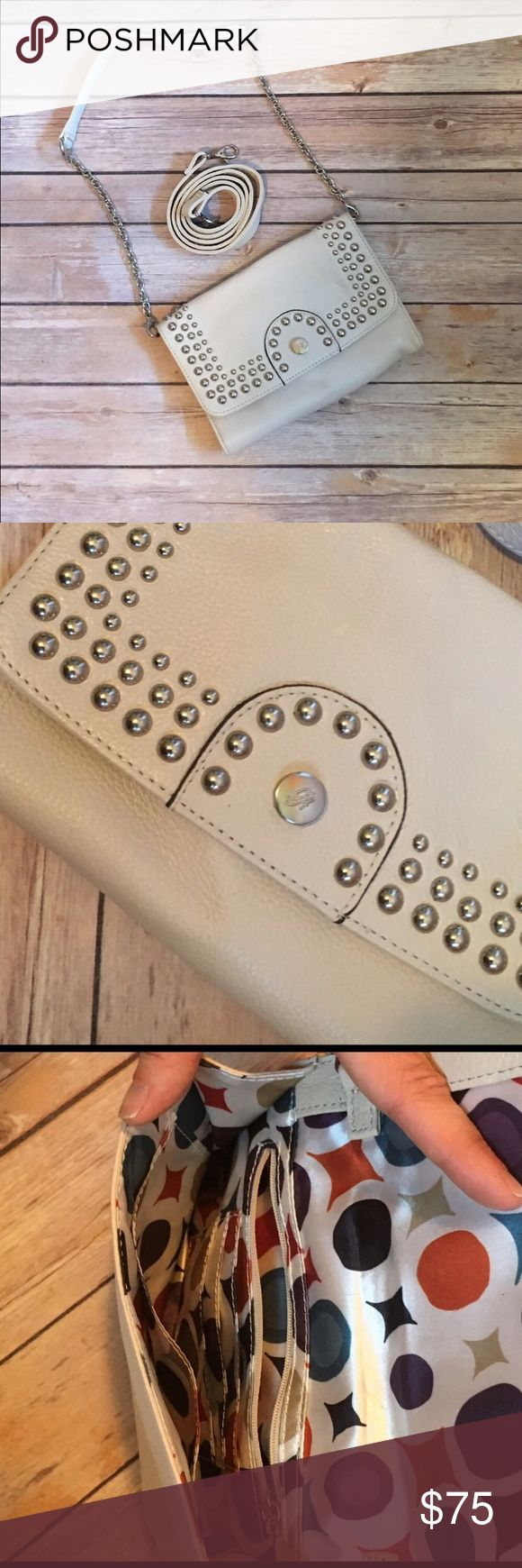 Grace Adèle Leather Cream Paige Clutch Genuine leather clutch. Used once or twice. EUC. Comes with two changeable straps. Can be used solo or with straps. Cream/off white color with silver accents Grace Adele Bags Clutches & Wristlets