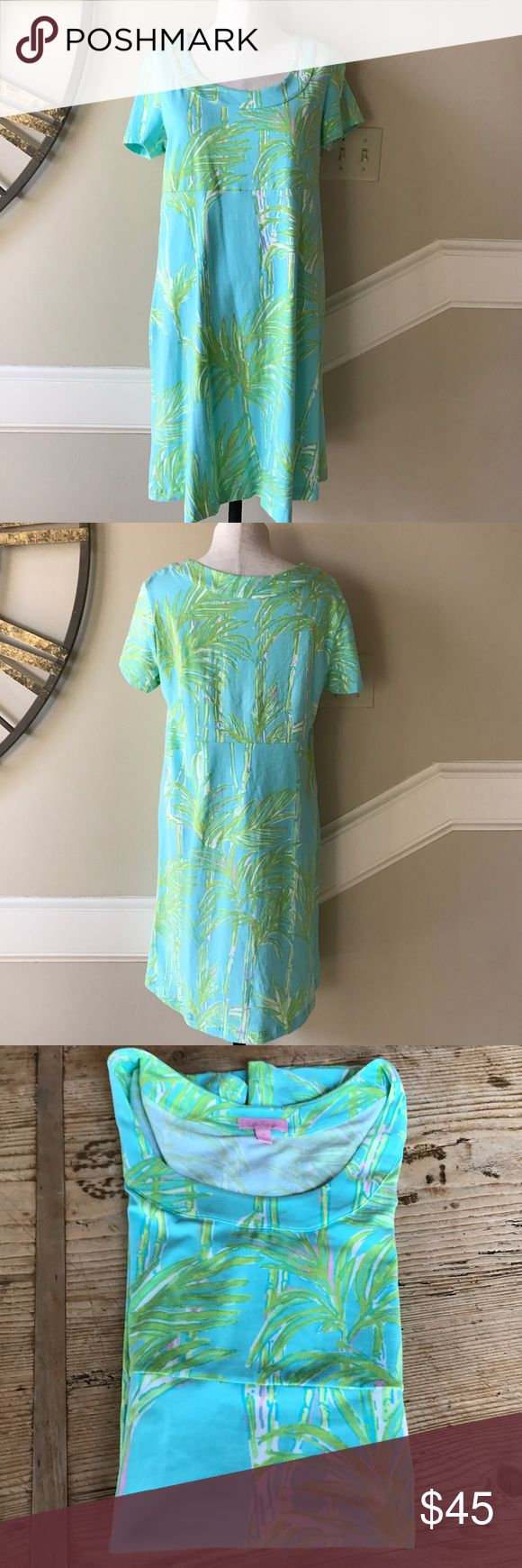 Lilly Pulitzer Kelsey knit dress size M Super cute and oh so comfortable Lily Pulitzer Kelsey knit dress size medium. No flaws. You will lounge around the pool or beach in this all day long. This Lilly Pulitzer dress has the tropical shades and palm tree pattern to get you resort-ready. Wear with your favorite nude sandals for a casual, airy look. Surf blue/palm tree print knit. Scoop neckline. Short sleeves. Seamed Empire waist. Skirt falls straight above knee. Cotton/spandex. Imported…