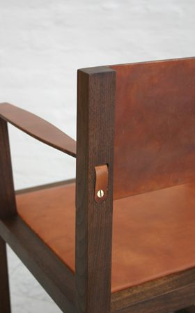 Detail with leather and black walnut on the Square Guest Arm Chair at BDDW