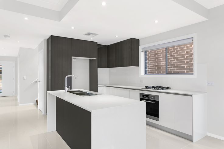 Kitchen In A Custom Designed Home With Waterfall Ends