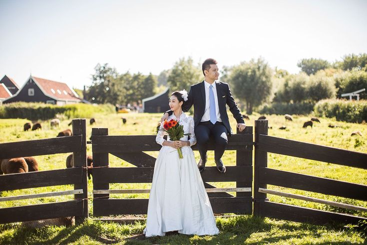 Pre wedding engagement shoot at Zaanse Schans Windmill village near Amsterdam, Holland. Pre wedding photography in the Netherlands, France, Italy, Spain, Europe by Dario Endara Wedding Photography