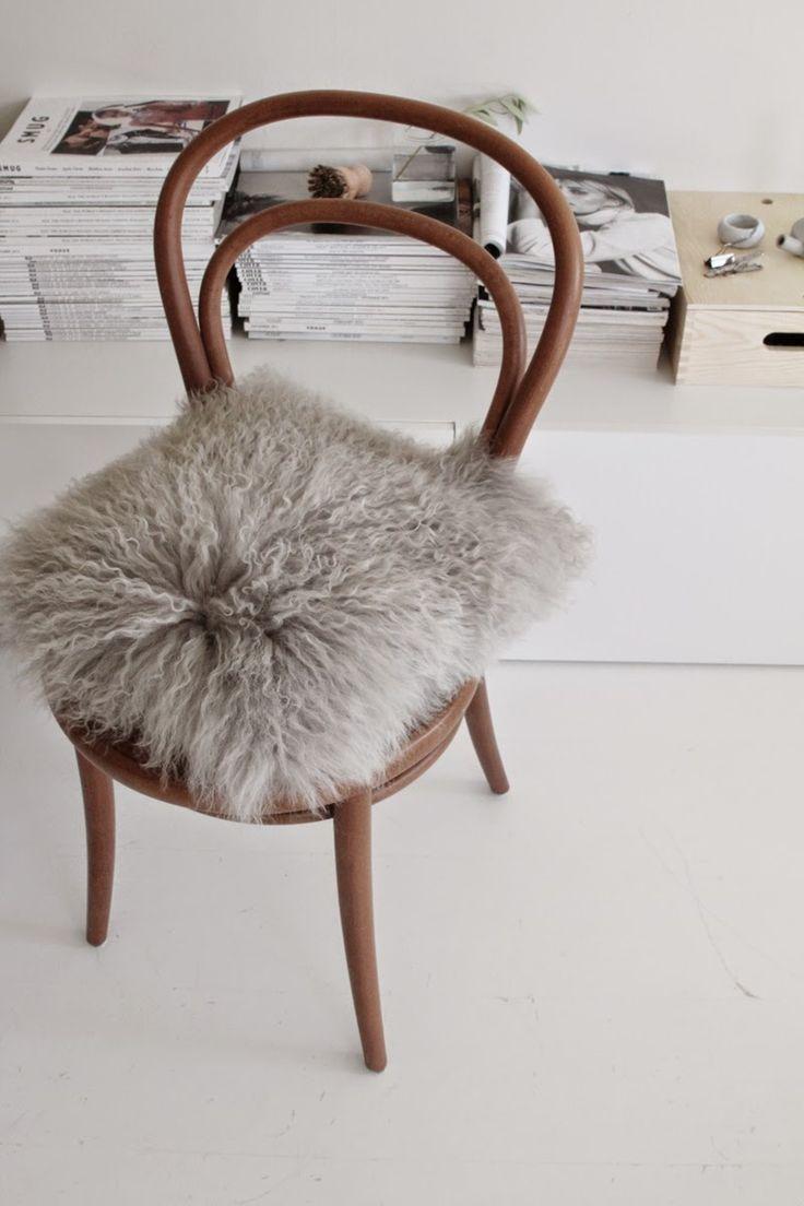 Grey lambfur cushion from Bloomingville