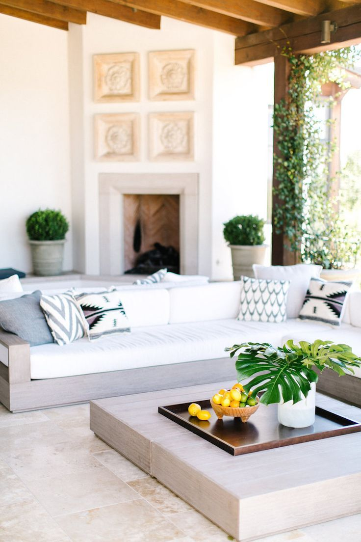 Extravagant fireplace steals the show stone fireplace for the spacious - Camille Styles Modern Mediterranean Patio Makeover