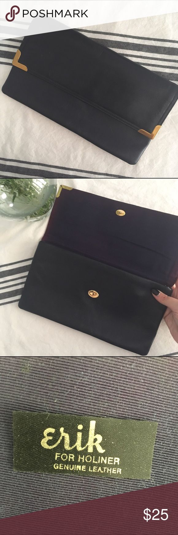 Vintage genuine leather navy clutch C. 1950s envelope-style Eric for Holiner clutch. Dark navy in great condition. The purpleish fabric on the inside has faded. Button close with great gold accents. Eric for Holiner tag is sitting inside the zipper pocket inside. Vintage Bags Clutches & Wristlets