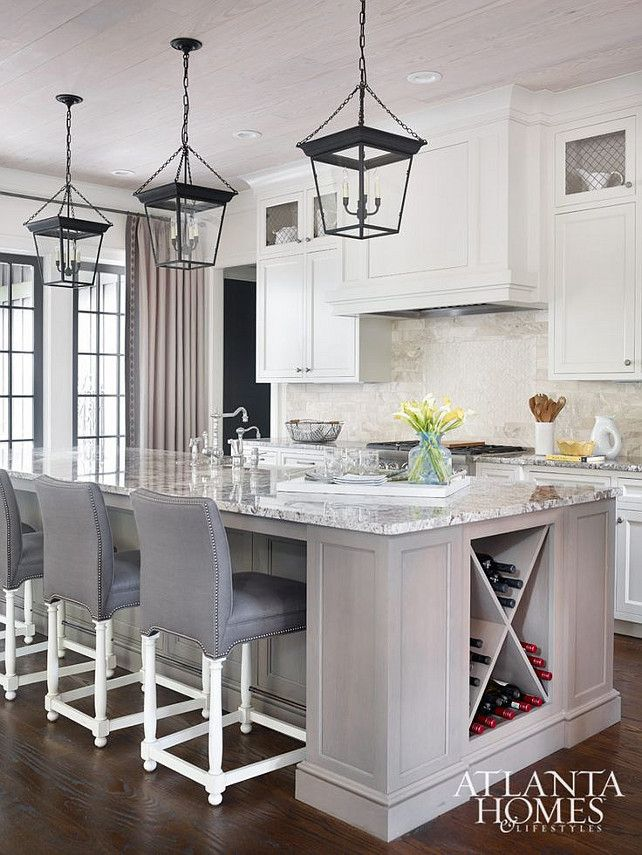 Kitchen with white washed kitchen island and ceiling with white cabinets and lantern. #kitchen Atlanta Homes and Lifestyles.