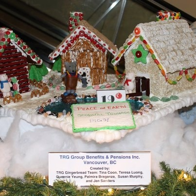 """The TRG Team supports the """"Make a Wish Foundation of BC & Yukon by building a Ginger Bread House that Three Little Pigs can live in. Gingerbread Lane & the Enchanted Village is Located in the Hyatt Regency Hotel lobby"""