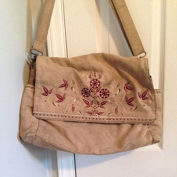 """Cute diaper bag Tan color with burgundy flowers. In good condition. Pockets in both sides, one pocket in the back and 3 compartments inside. 11""""H, 18""""W. 6"""". It has a small stain as show in the picture  Bags Baby Bags"""