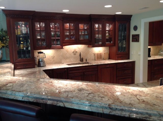 LKB Kitchens: Basement Bar With Laminated/ Stacked Edge Granite Countertops,  Cherry Cabinets.