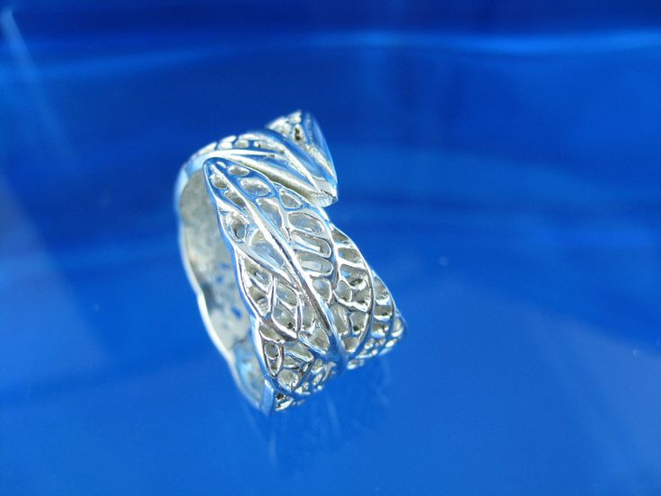 a delicate lace like leaf ring in sterling silver
