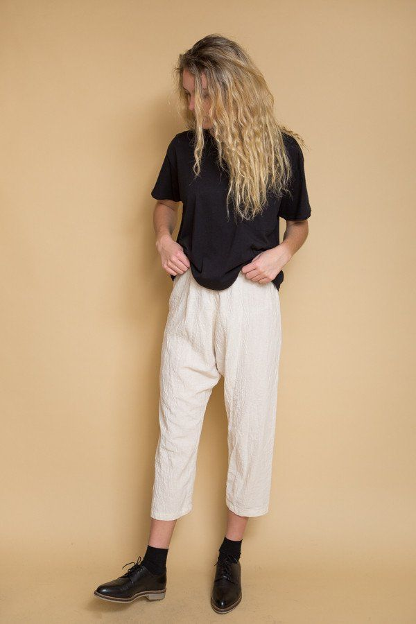 """Comfortable, drop-crotch textured pull on pants with from Uzi NYC. Features a comfortable slim, elastic waistband, and a loose fit. Model is 5' 9"""" and wears size small. - 100% Cotton - Hand wash with"""