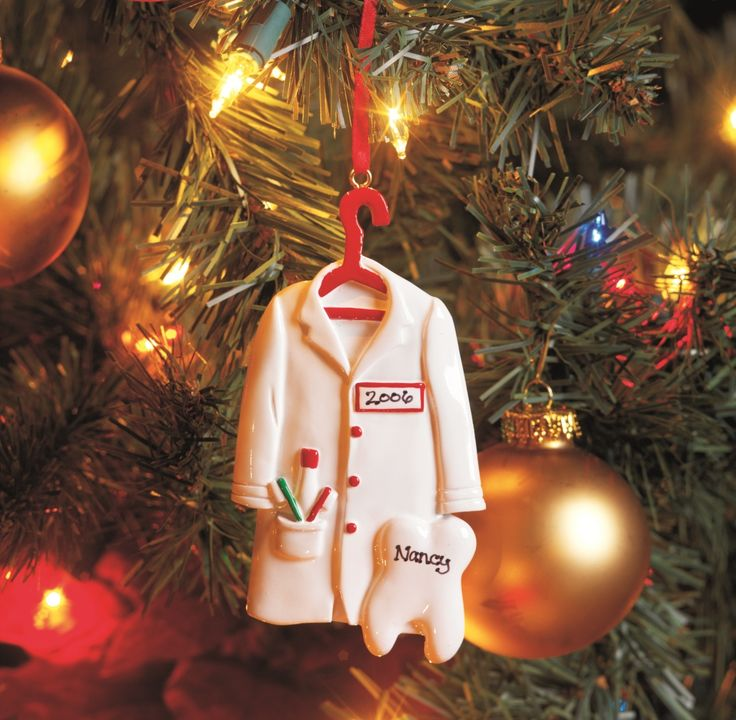 Dentist White Coat Ornament, Personalized Dress up the holidays with this hanging dentist's coat and molar ornament. Personalize with name and year for a gift to be treasured again and again.