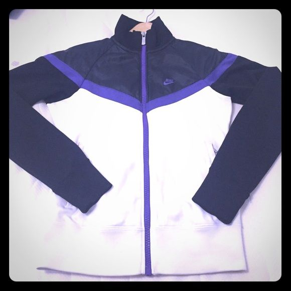 Stylish Womens Nike sports jacket Very smart jacket used for running a few times. Very smart design . Nike Jackets & Coats