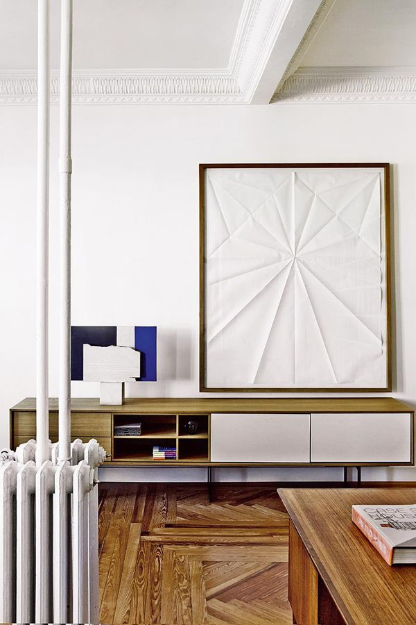 Beautiful vignette with Mid Century storage and contemporary art.