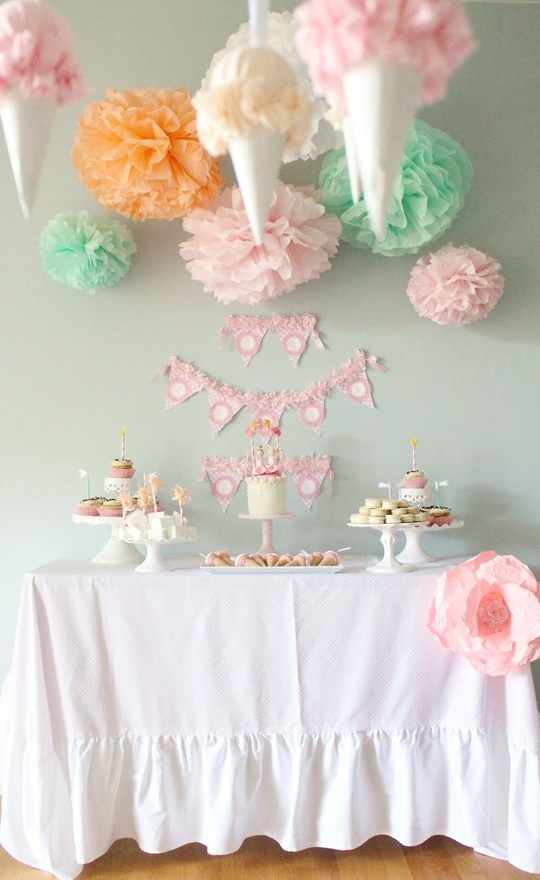 fluffy baby shower or girls bday party idea- tack Pom Poms to wall if cannot hang