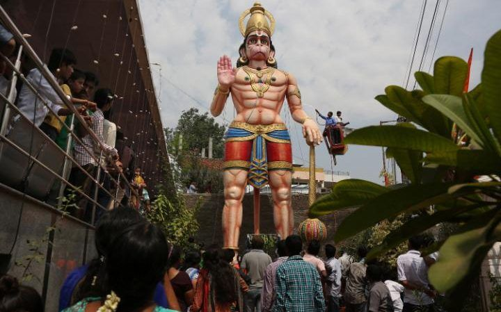 Hindu devotees watch as a 40 foot (12m) high statue of Hindu monkey-god Hanuman is washed during Hanuman Jayanti, the birthday of Lord Hanuman in Hyderabad, India.