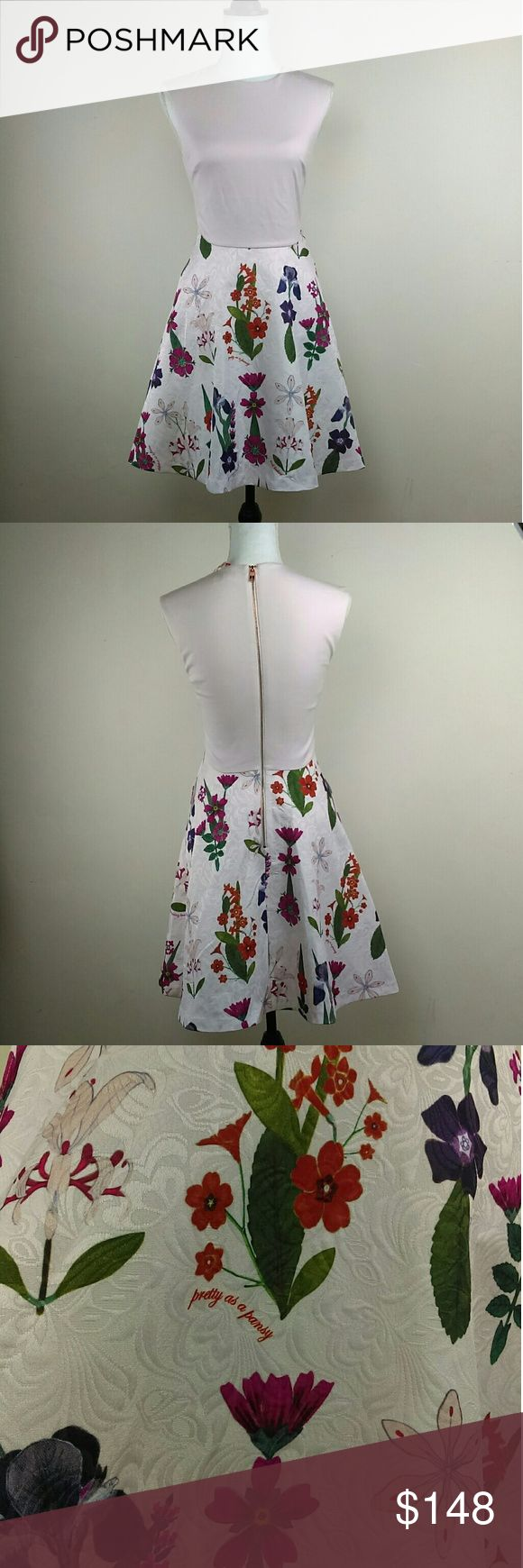 New NWOT Ted Baker Pretty as a Pansy Garden Dress Brand New! This dress is so pretty my photos do not do it justice. It has a fitted pale pink top and a floral skirt with two hip pockets. It zips up in the back. This is a brand New dress and tag was cut off for no returns but it still has partial.   Ted size 1 USA SIZE 4 Ted Baker Dresses
