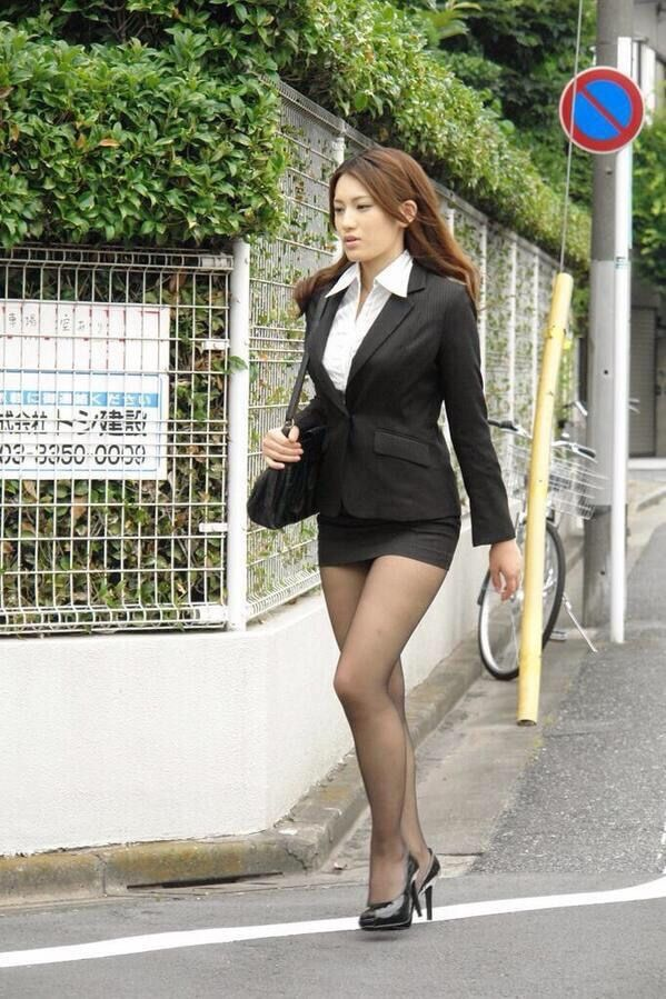 Sexy asian in miniskirt, tights / pantyhose and heels