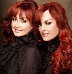 Mother and daughter singing duo the Judds. Naomi and Wynonna.