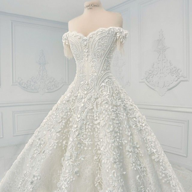 """""""MARIAN RIVERA wedding dress is made of Solstiss French lace with French paillette, minute Swarovski pearls, chalkwhite Searovski crystals and studded with…"""""""