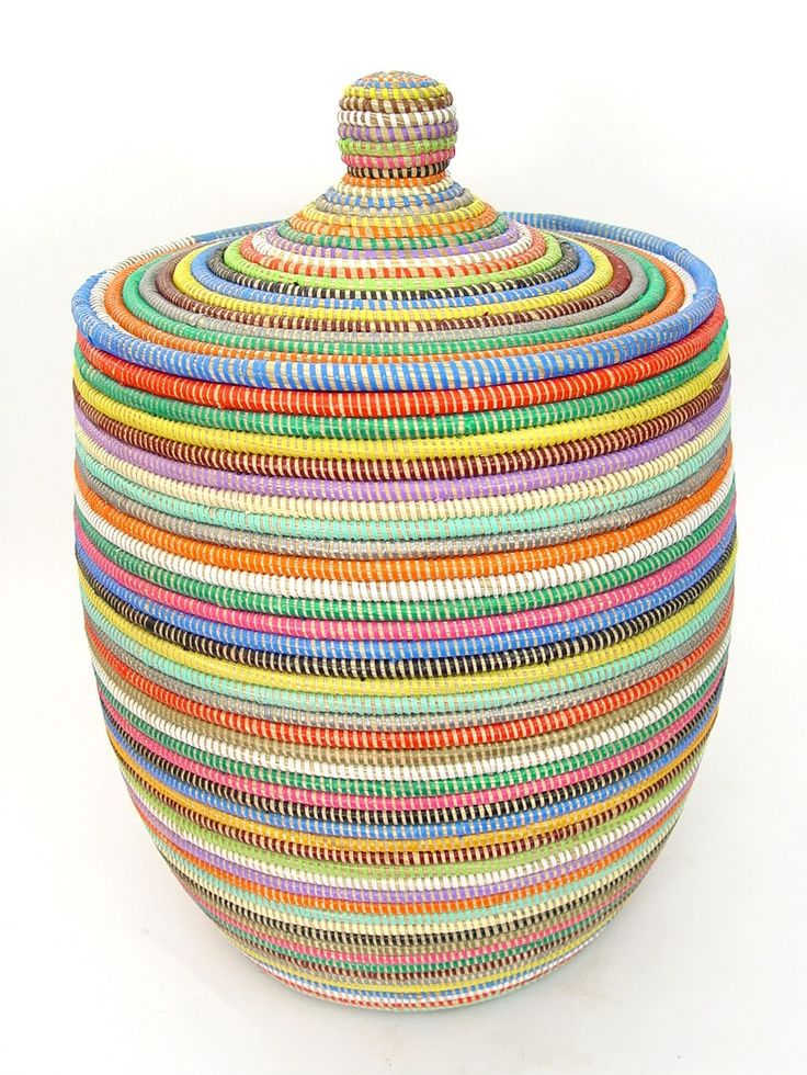 """Senegal Woven Basket - Medium Multicolor  $90.00. This fabulously fun African basket adds a colorful splash of African decor to any room. Use as a storage container, a laundry basket, or a purely decorative accent. Our baskets have both practical functionality and contemporary style.    The baskets are hand woven in Senegal from cattail, a grass-like plant, and colorful plastic threads which add strength and durability. Bring one home today!     Height: 22""""  Width: 14""""  Made in: Senegal"""