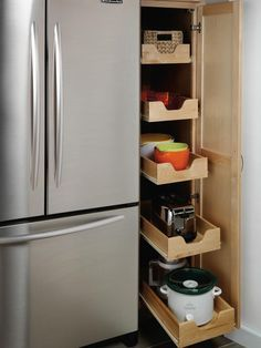 Pullout cabinet drawers work equally well in pantries or in the main kitchen area.