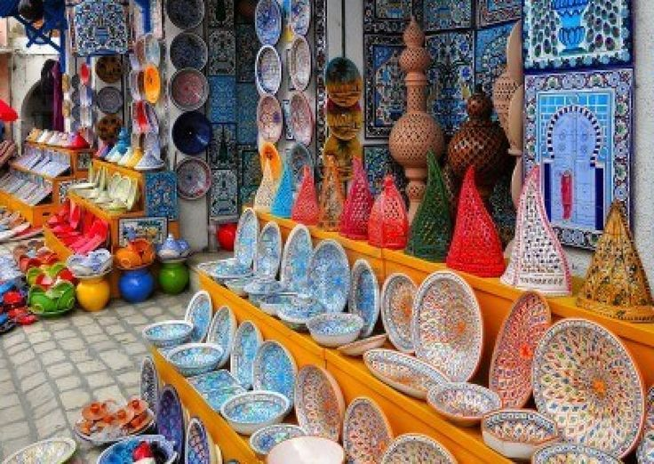 Colorful Tunisian pottery in front of the souvenir store in Nabeul, Tunisia.