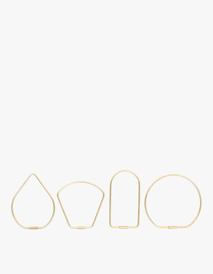 From Areaware, a brass key ring with a minimal screw clasp. Designed by Karl Zahn to be worn around the wrist or clipped to a belt, made from 10 gauge brass wire. Shown left to right, the tear shaped Drop, a bowed out Bell, the straightforward Bend, and t