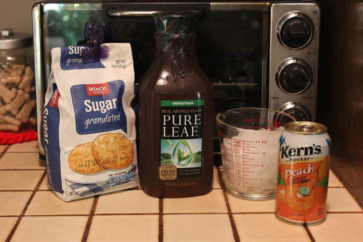 Olive Garden Peach Tea Ingredients: 2qts unsweetened fresh brewed tea; ¾c sugar; 11oz can peach nectar; Ice