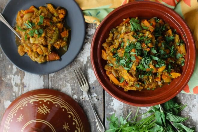 Garden Vegetable Tagine is a classic Moroccan vegetarian dish using garden root vegetables, sweet and savory spices, Mina Harissa, garnished with fresh herb