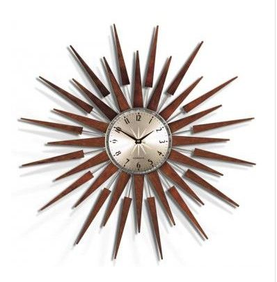 Pluto Wall Clock from Home Decorators Collection.  A showpiece and a timepiece, the Pluto Wall Clock will quickly become the focal point in your home thanks to its starburst design featuring wooden rays and metal spokes.  Get your rebate from RebateGiant.