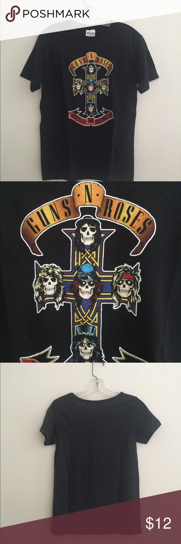 Guns N Roses Appetite For Destruction Tee Guns N Roses Crew Neck Logo T-Shirt Front: Slash's iconic totem cross artwork from the Appetite For Destruction album. Plain black back. Size:  Adult small 34/36 Excellent condition. 1oo% Pre shrunk cotton. No flaws. No fading, piling or holes. Shirts Tees - Short Sleeve