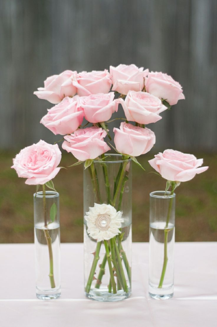 This is a great example of roses arranged simply and beautifully. Whether a single stem or a few more, roses are timeless! Shop roses and other popular wedding flowers at GrowersBox.com.Centerpieces Ideas, Pink Wedding, Pink Roses, Wedding Flower Pink Rose, Rose Centerpieces, Simple Centerpieces, Centerpieces Pink, Simple Pink, Pretty Flower