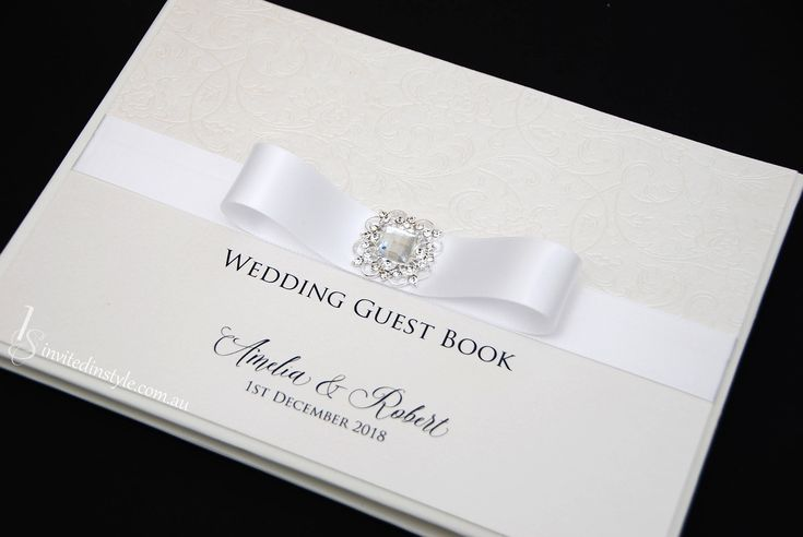 Wedding Guest Book - Personalised, hardcover with flourish embossed paper, white ribbon and a Victorian brooch by InvitedinStyle on Etsy