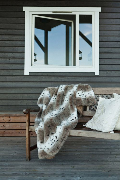 Stark and cozy, that's pretty hard to accomplish. Very Scandinavian. Curl up with that blanket, sip your coffee and watch the sunrise.