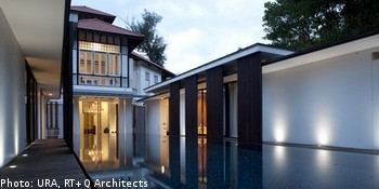 A black and white house that gets a 4m renovation that includes two extensions and a pool. Picture of the house flanked by the extensions.