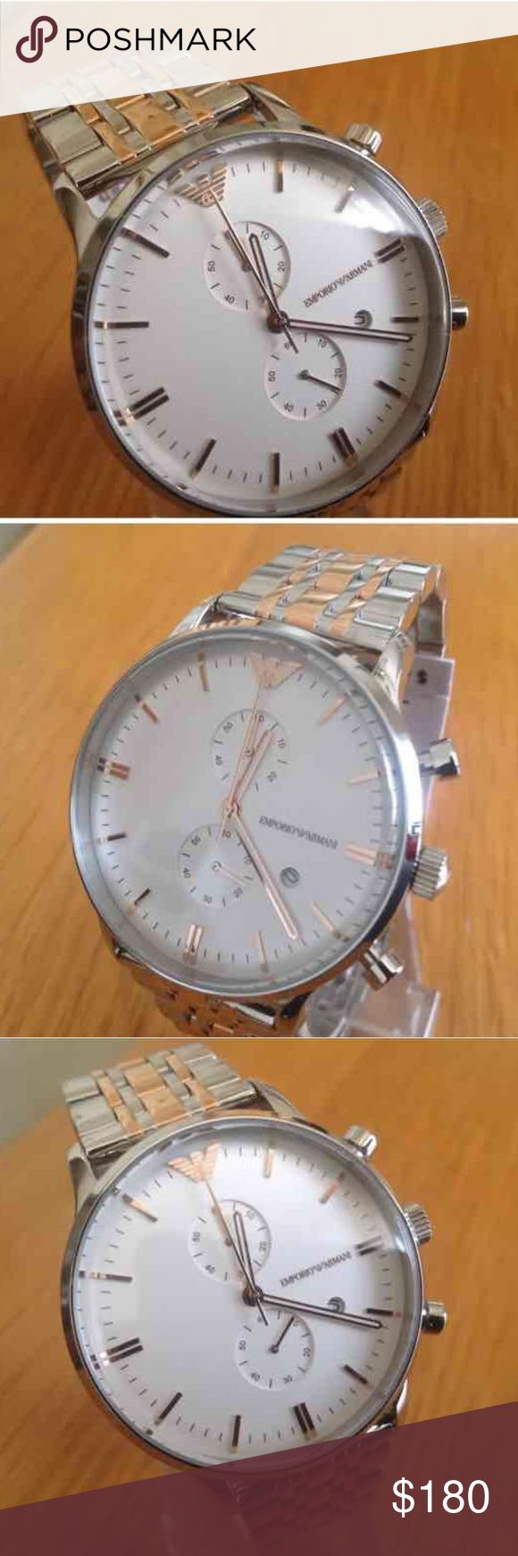 Mens watch Stunning men's silver watch with a RoseGold inlay. Case Size 44mm   Band Width 22mm Retail $445.00 Accessories Watches