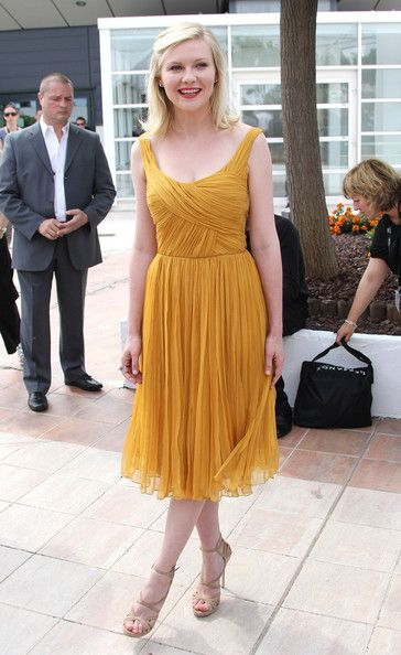Kirsten Dunst in a mustard colored dress at the 'Melancholia' photocall at the 64th Cannes Film Festiva.    (May 18, 2011 - Source: PacificCoastNews.com)