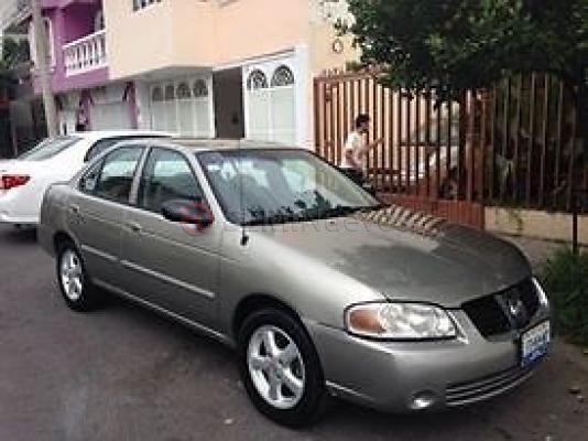 Nissan Sentra 2005 Sedán disponible en Guadalajara. 81751 Kms., 1800cc, 4 x 2, Tela, Hidráulica, Automática, Gasolina, Eléctricos, Gris, Aire Acondicionado. Compra, vende o cambia el Autos de tus sueños en SEMINuevos.com.