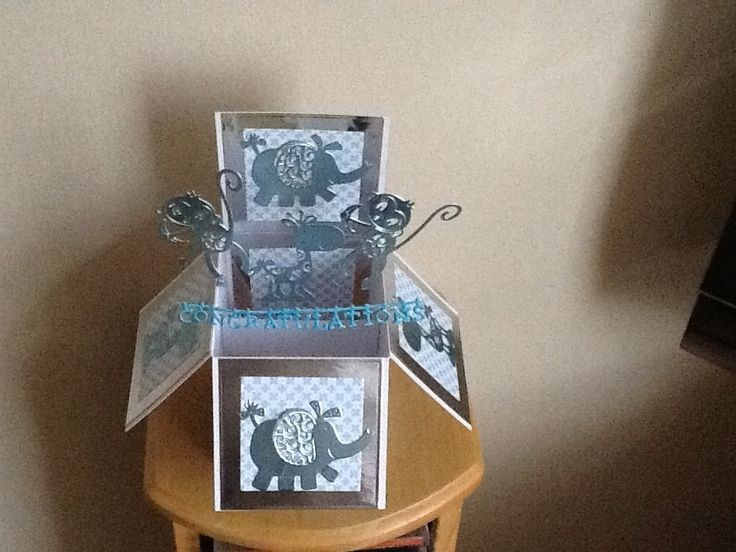 Made by Georgina Smith - I made a new baby box card using the little monster dies.