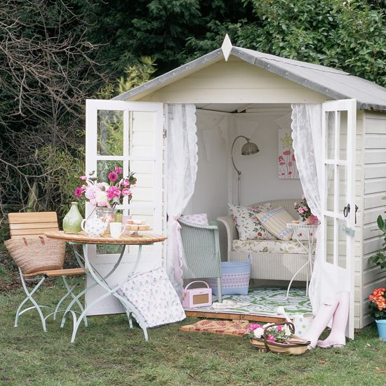 A very charming and beautiful shabby chic garden hut that every garden needs