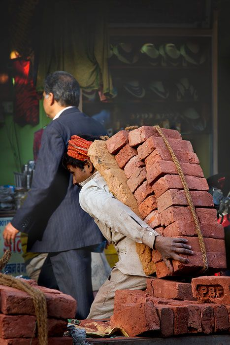 INDIA - OLD DELHI - Back breaking work// Integrity would never support what condones this.