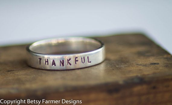 Hey, I found this really awesome Etsy listing at http://www.etsy.com/listing/84875602/personalized-hand-stamped-ring-sterling