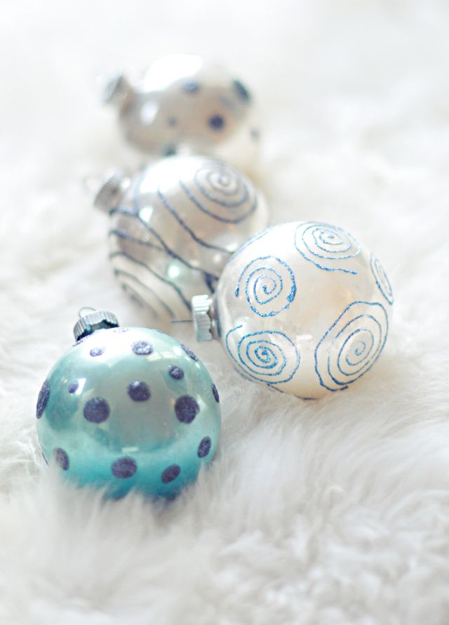 Easily give your old Christmas ornaments new life with glitter glue!