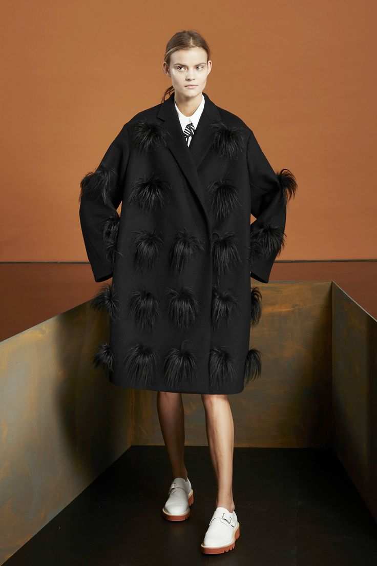 Stella McCartney Despite being wholly committed to non-cruel materials, Stella McCartney brought out an abundance of fur-looking pieces for pre-fall. (Don't worry, this faux fur comes with a removable tag that tells the world exactly what it is.) The pieces were paired with beautiful knits and cheeky flats, as well as unique picks that quirky girls are bound to go gaga over (shin-pocket trousers, furry hats, panther prints, and lots of haphazardly gathered gowns).