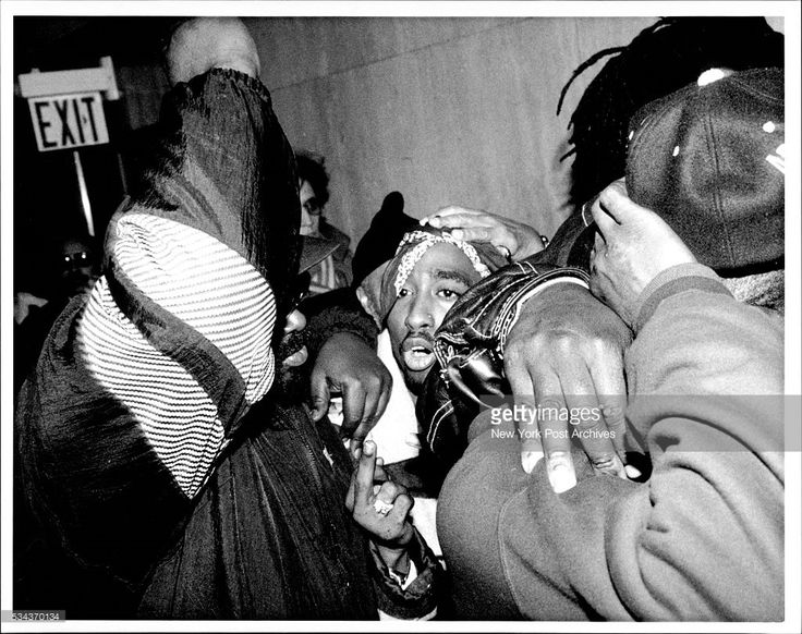 Rap Singer Tupac Shakur at Criminal court 100 center St. Manhat. For alleged assault hearing on Bail. Continuously giving The Finger to all camera people and uttering obscene remarks to them upon leaving Court. His Lawyers attempted to black photos. December 16, 1993. (Photo by Michael Norcia / (c) NYP Holdings, Inc. via Getty Images)
